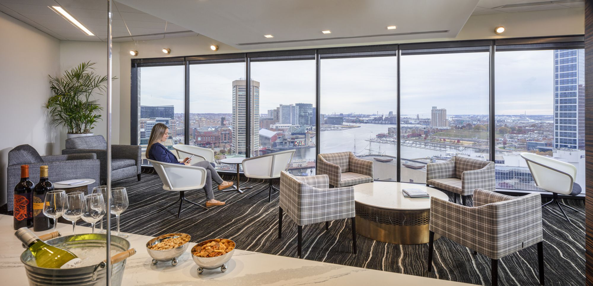 After a long day in the conference center, clients can unwind in the club room and enjoy the harbor.