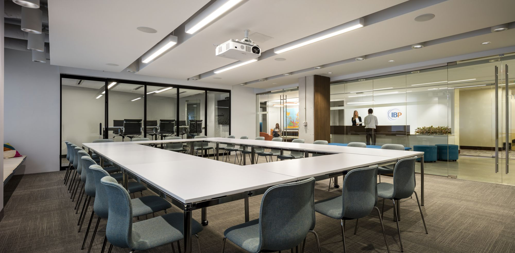 The meeting room has flexible tables and a glass operable wall to expand the room or create a prefunction space.