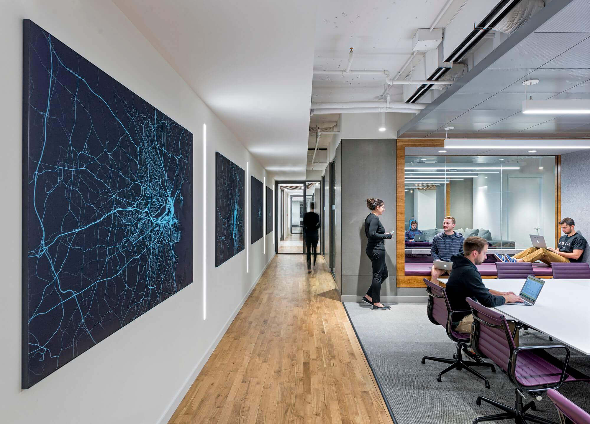 "Open and flexible meeting areas are accentuated by custom art panels, denoting ""heat maps"" of the Uber trips taken in major East Coast markets."