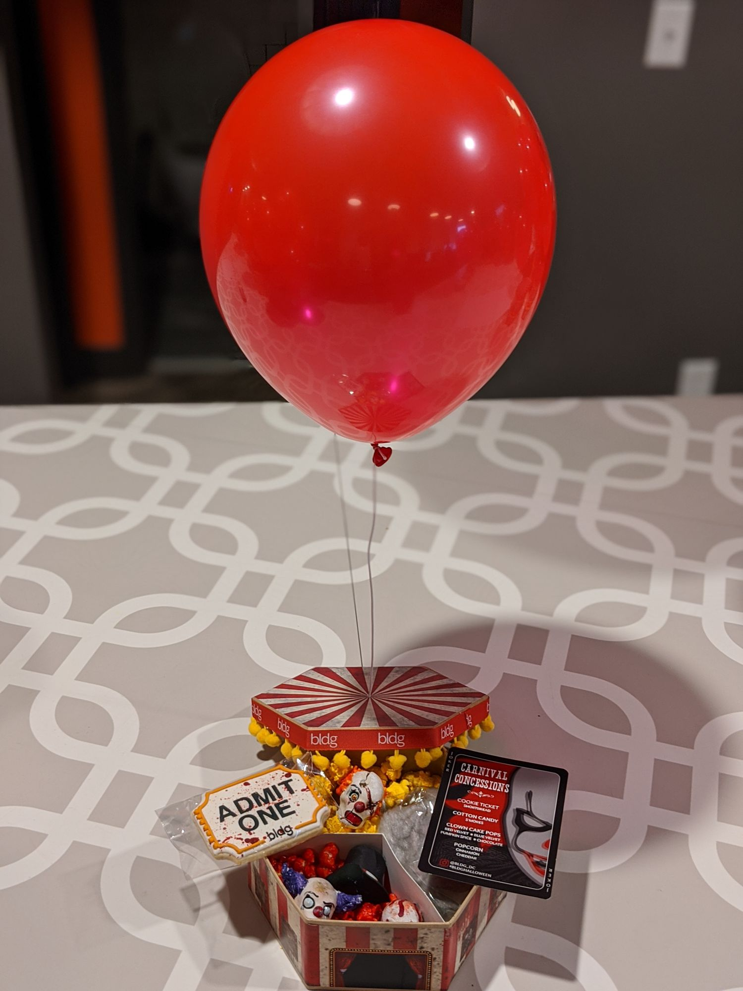 Along with popcorn and custom flavored cotton candy, we couldn't resist the single red balloon on top.