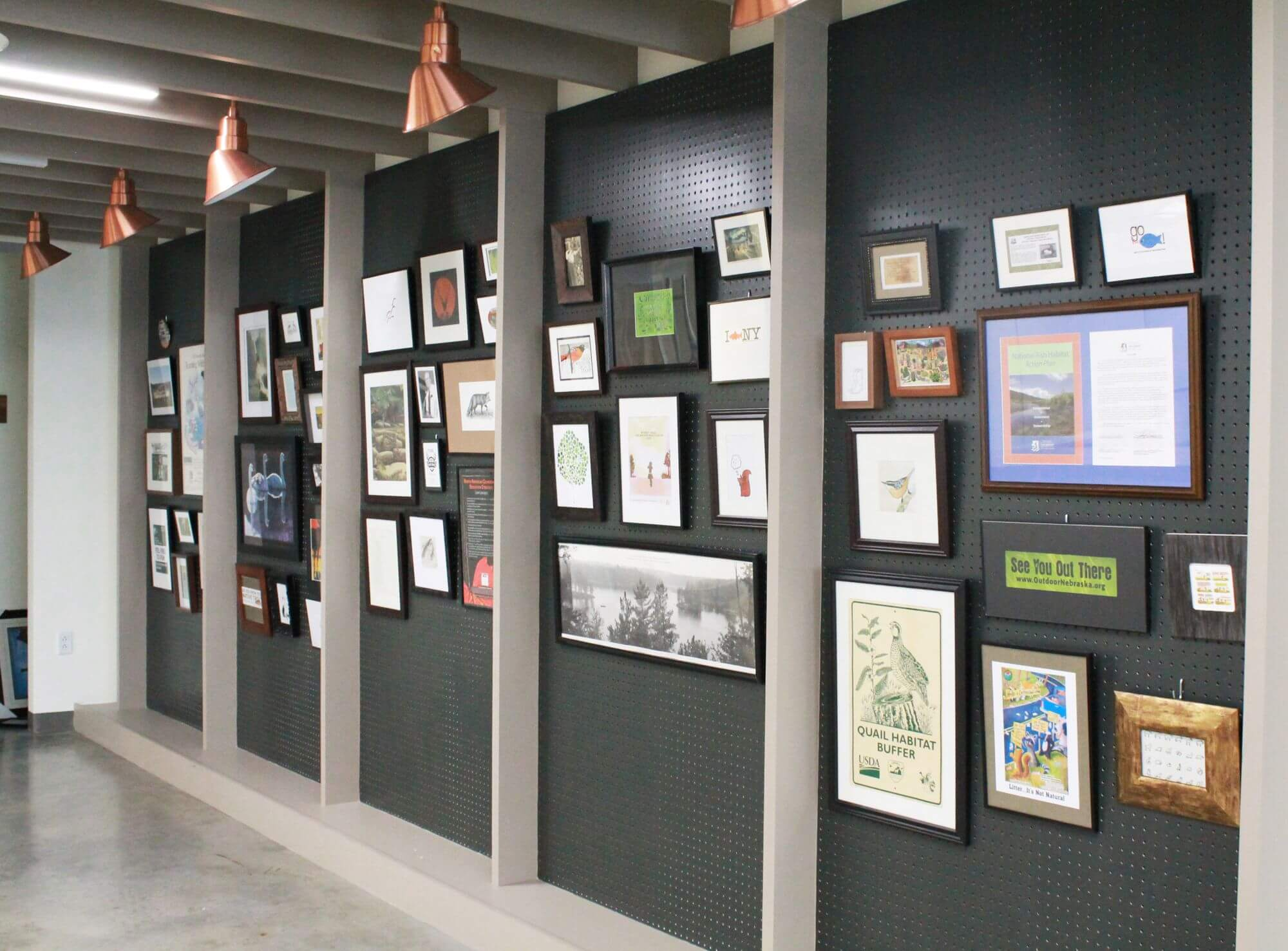 A Masonite peg board in the reception provides a space to display art and memorabilia from AFWA staff and their members.